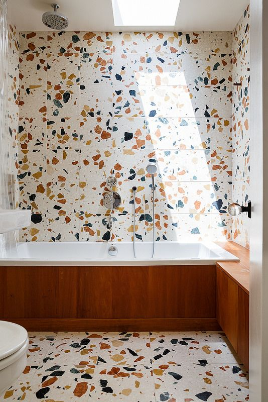 03-colorful-terrazzo-with-large-spots-on-the-walls-and-floor-and-a-wood-clad-bathtub