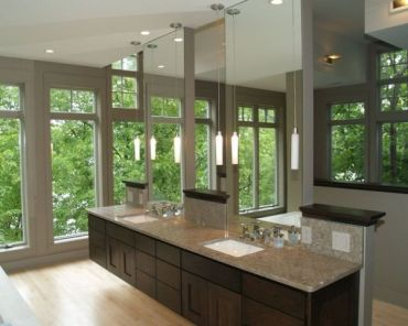 Floating-vanity-along-with-ampe-use-of-glass-give-this-master-bath-a-spa-like-feel
