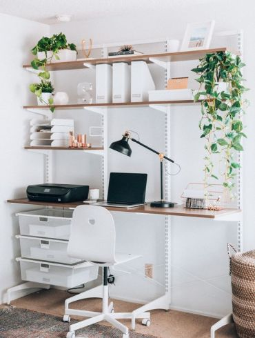 A-wall-mounted-shelving-unit-with-lots-of-shelves-and-boxes-for-storage-plus-a-built-in-desk