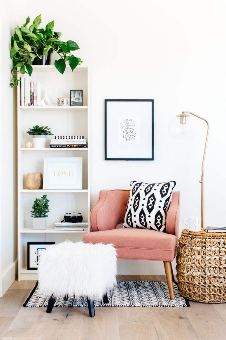 05-a-cozy-corner-with-a-pink-armchair-a-floor-lamp-and-some-poufs-is-an-ideal-reading-nook-and-is-very-inviting-775x1164