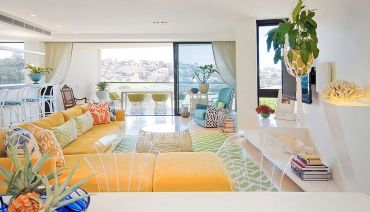 Bright-colors-of-the-80s-and-pattern-of-boho-beauty-coupled-with-chic-bakdrop-in-the-living-room-47797