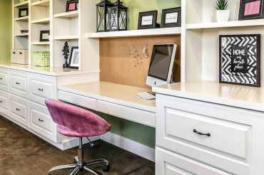 Office-desk-built-in-with-drawers-shelving-corkboard-wall