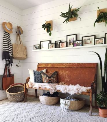 20-a-summer-boho-entryway-with-potted-greenery-a-bench-with-printed-pillows-baskets-for-storage-and-wicker-elements