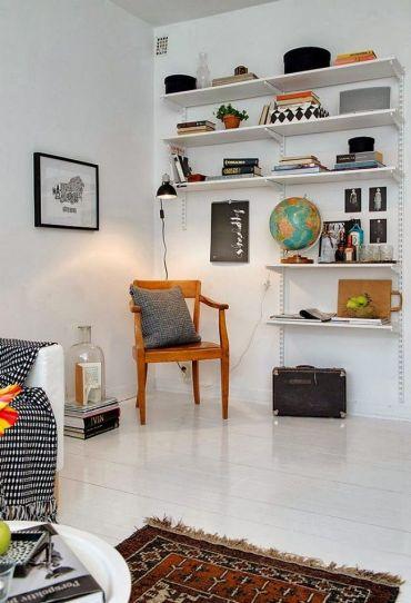 Wall-mounted-adjustable-basic-shelf-in-living-room