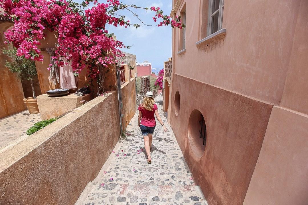 Juliana Dever walking away bouganvillea
