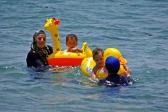it doesn't matter what u wear, while swimming - point is having lots of fun