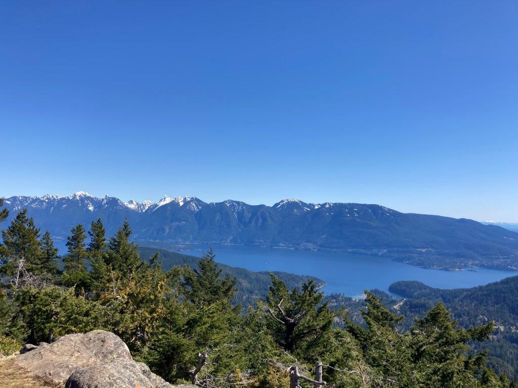View of the water, trees and mountains from Mount Gardner - a Bowen Island hike
