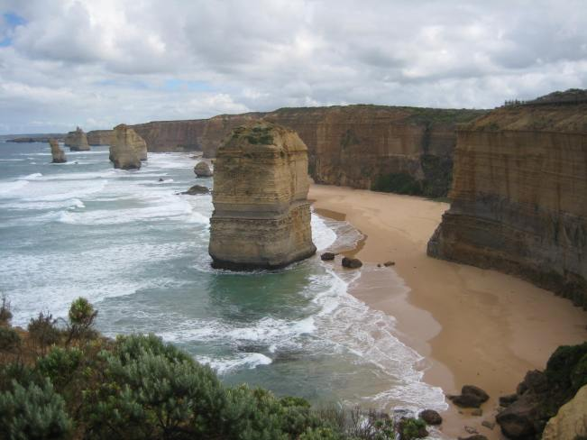 The Twelve Apostles rocks jutting out of the ocean, one of the sights along the Great Ocean Road