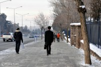 A walking lesson - a blind man flies throgh the icy streets.