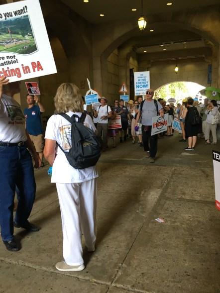 Demonstrators marching through the corridor of City Hall.