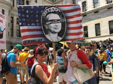 Parisa Vahdatinia, 31, holds a sign calling for Hillary to be indicted.