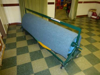 Rolled up bowling mat