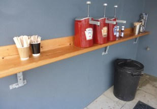 Compostable knives, forks and coffee stirrers and bulk ketchup, at Norbar, north of Barmouth