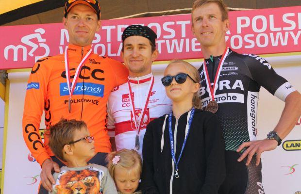 Marcin Białobłocki, Michał Kwiatkowski i Maciej Bodnar na podium wyścigu