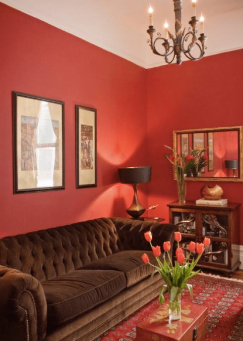 Vibrant Red Living Room Walls And Brown Furniture