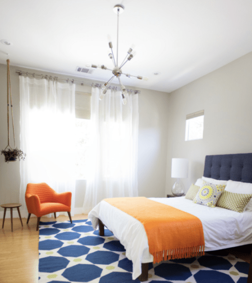 We love paint (obviously!) but there are other ways to combine blue and orange. Use it in fabrics for a pop of colour in a neutral space.