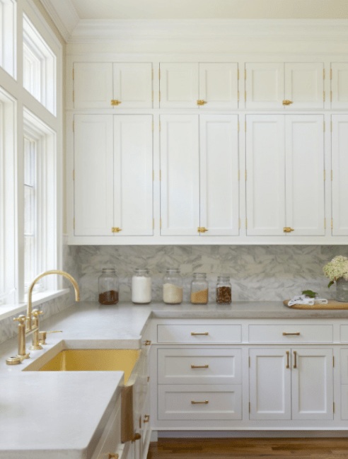 In addition to gold hardware, this kitchen really glams it up with a gold sink and faucet.