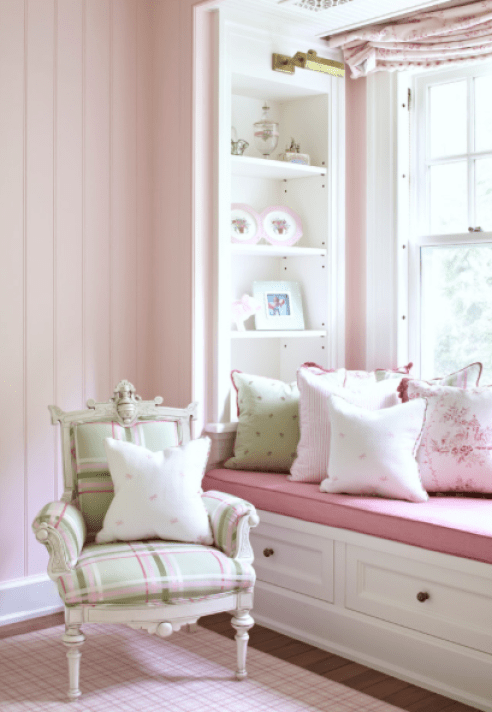 Best seat in the house! Soft green and pink add a girlie touch to this chair and window seat.