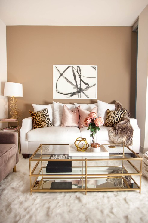 Have fun with patterns and texture. Touches of animal print, a super soft rug and metallic accents give this living room dimension.