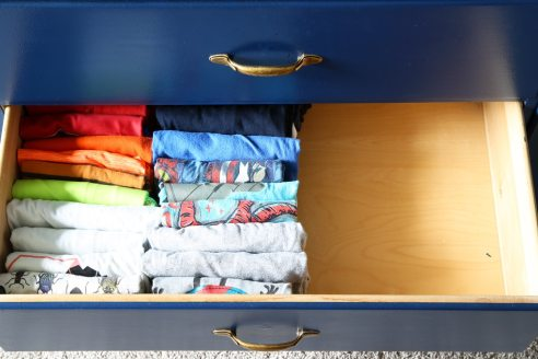 Instead of stacking your clothing in drawers stand it up in rows so everything is easy to see.