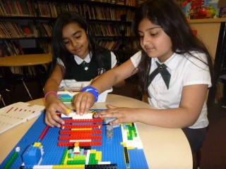 Robotics club members building their 3D objects