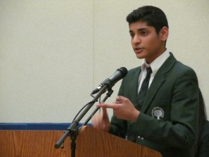 A student defending his position during the RMS Debate Night