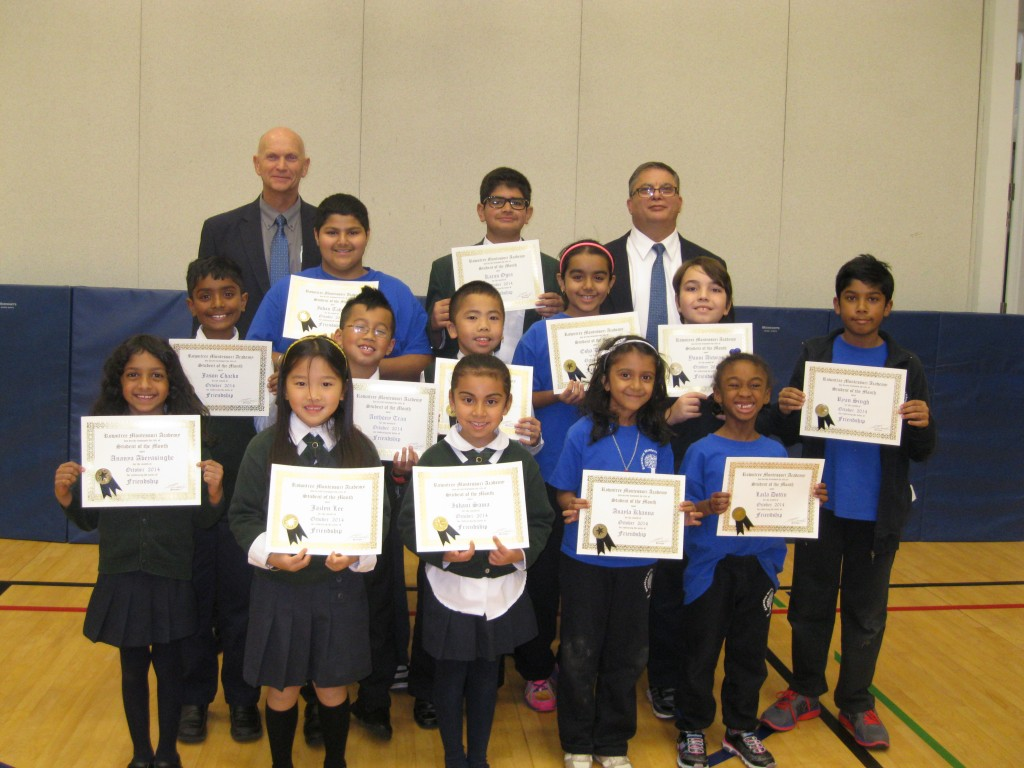Students proudly displaying their 'Student of the Month' certificates which they earned for the value they embodied in their behaviour