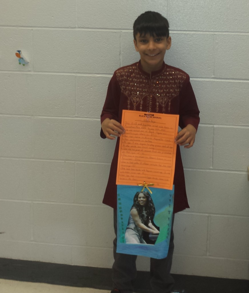 A student displaying their project