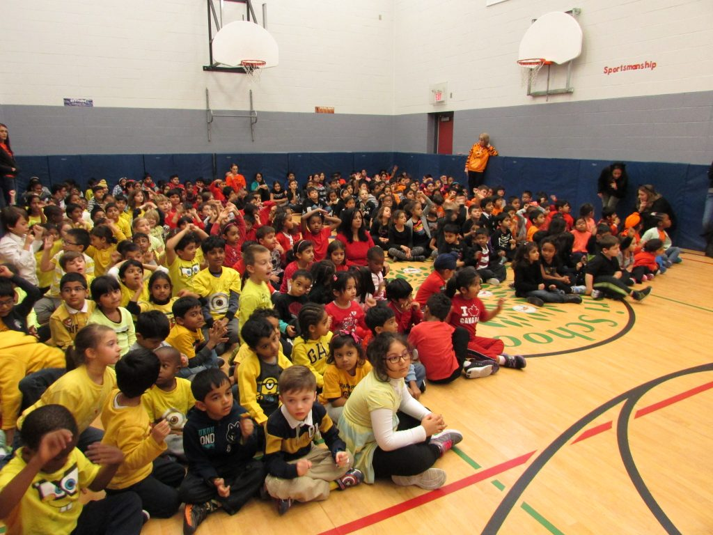 Our Spirit Day assemblies bring the students together in their house colours!