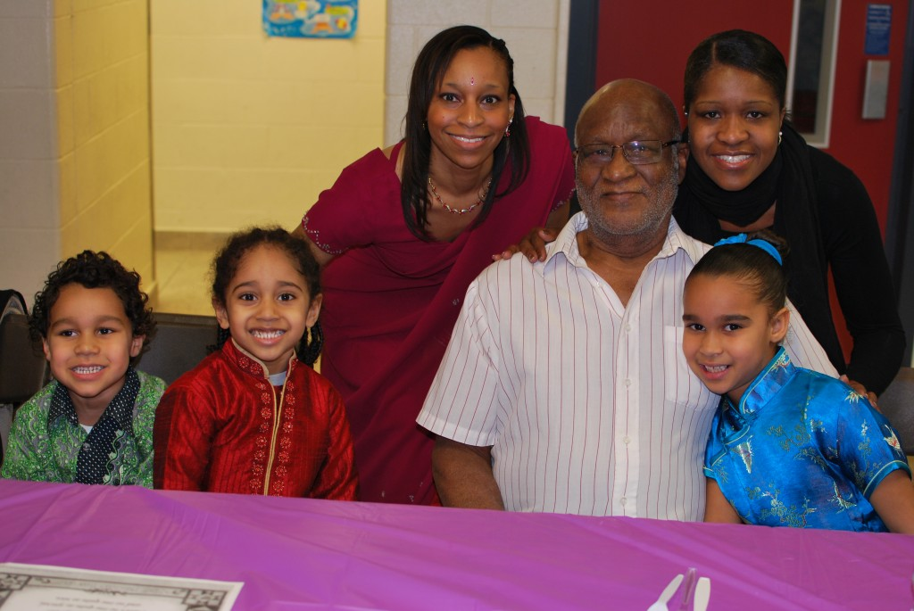 Three generations of family members enjoying the international day pot luck luncheon