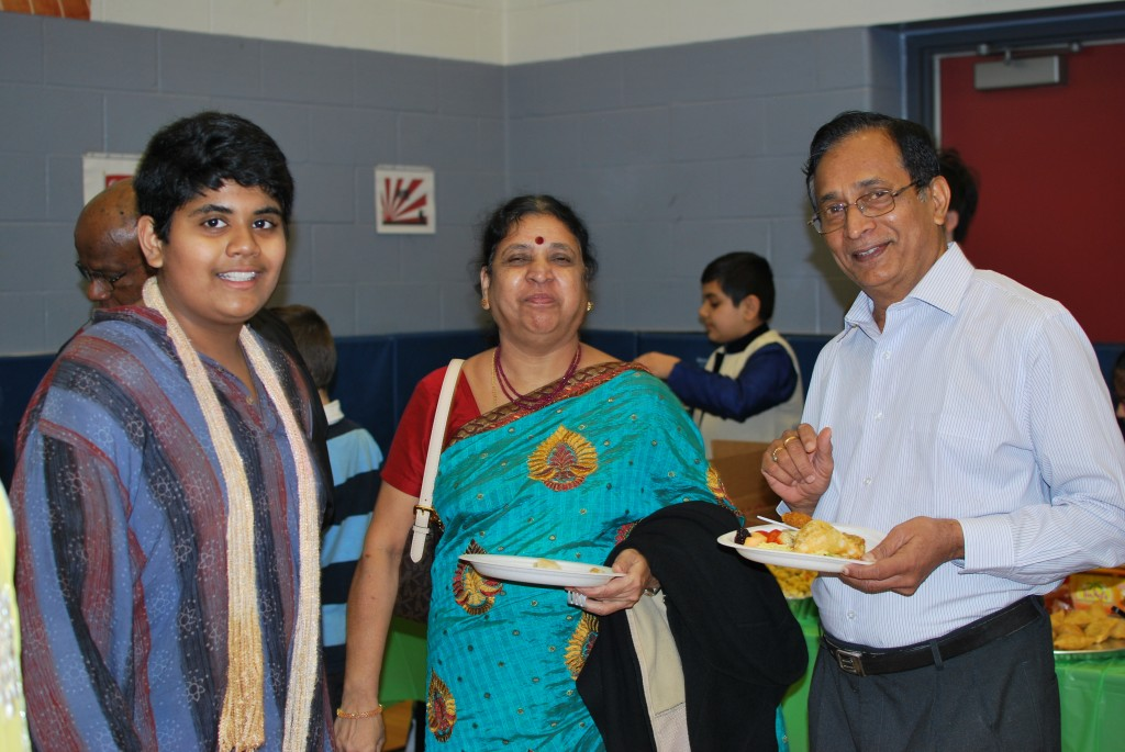Parents and Students dining together at the international day pot luck