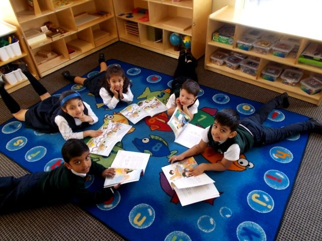 RMS private school students reading in a circle