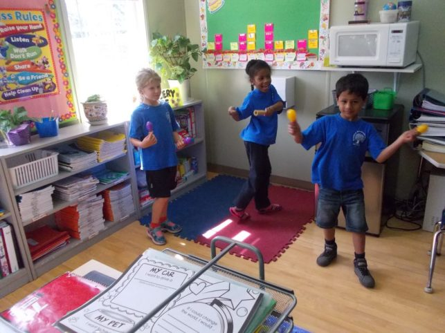 RMS Private School students dancing and playing musical instruments