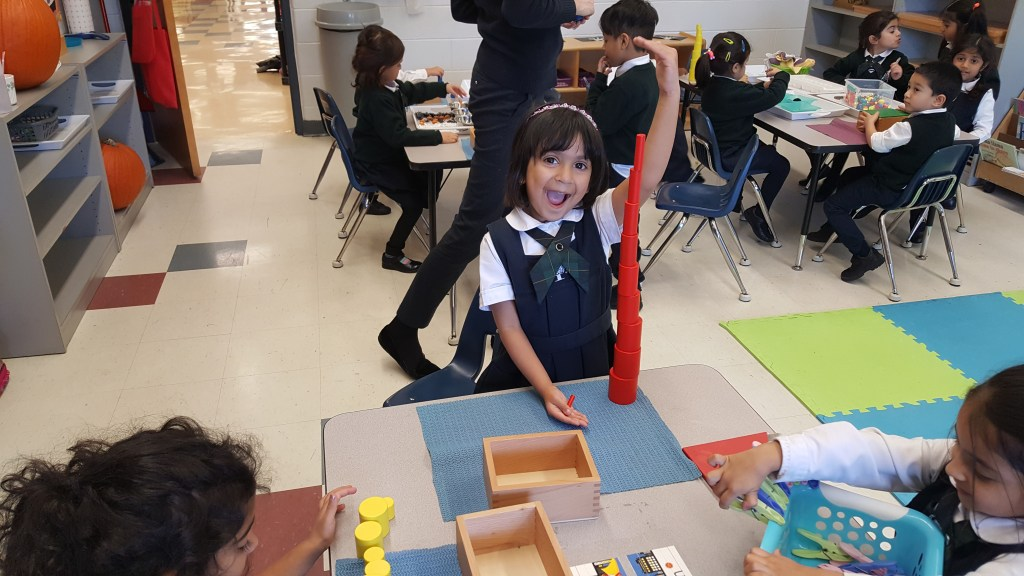 Student working in class with Montessori materials at Brampton Private School