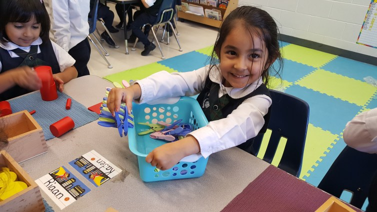 Kindergarten student using real-life materials to learn through Montessori teaching method