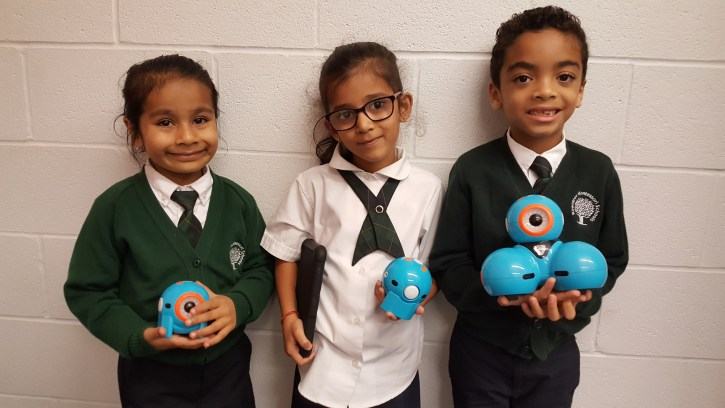 Students from grade 1 using dash and dot robots in the library at Rowntree Montessori Schools