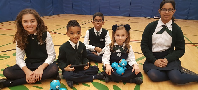 Rowntree Montessori Schools students sitting and using dash and dot robots at the top Brampton Private school