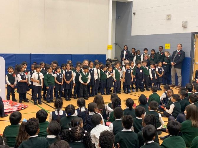 Kindergarten students reciting Remembrance Day poem at Rowntree Montessori Schools private school in Brampton