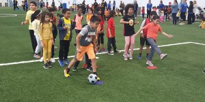 Students at soccer station during Mini Olympics sports day at Rowntree Montessori Schools in Brampton