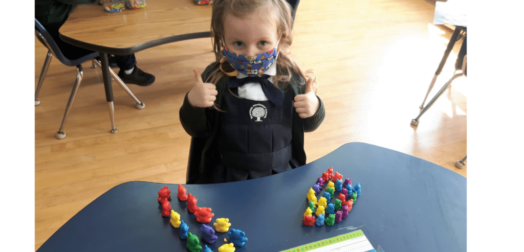 A Kindergarten student working on a new math concept during math time