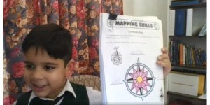 A student displaying his compass rose