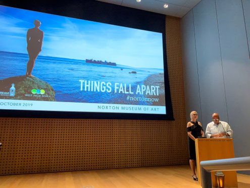 Ann Mallen and Eduardo Condes at the podium at the Norton museum of art speaking on climate change