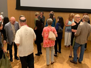 people chatting after the vent at the Norton museum of art, hosted by The Cream Literary Alliance