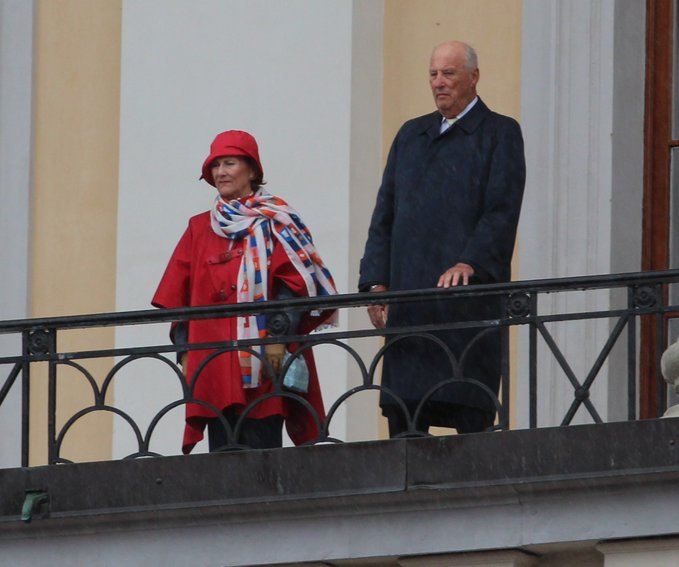 King Harald and Queen Sonja attend a military parade in Oslo