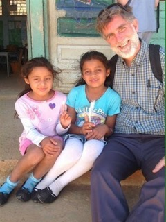 Dr. Tommy Ball with two school children in the Cedros community in the San Marcos District, Intibuca province of Honduras. COURTESY PHOTOS TOMMY BALL