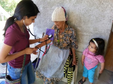 Medical student Sheila Kaypur examines a patient on a home visit in the community of La Majada.
