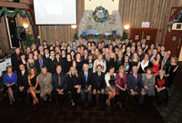 Attendees gather for a photo at the Royal LePage Champlain holiday party.