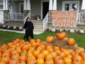 Nicole Beinert of Royal LePage Signature Realty poses with her pumpkin patch.