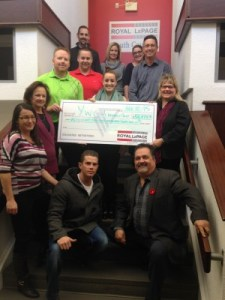 Members of the Royal LePage South Country Real Estate Services 'Royal Gala' committee and colleagues present event proceeds to YWCA Harbour House