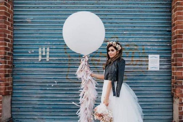 Prop Me Pretty Wedding Baloons and Decorations bride with balloon